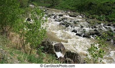 The Mountain River Boils and Quickly Moves Down the Mountain...