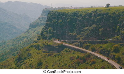 The Mountain Serpentine and Cars drive Along the Road in Armenia