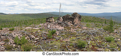 The mountainous landscape of the South Yakutia with rocks buttes
