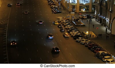 The movement of cars in the evening.