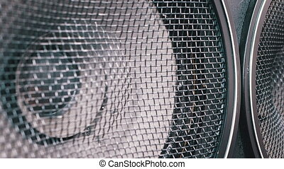 The Movement of the Vintage Paper Cone of Acoustic Sub-woofer Speaker. Close-up of Bass speaker membrane vibration and playing. Loopable. Powerful kind of subwoofer vibrates at low frequencies. Loud Speaker in Action. Loudspeaker with protective mesh.