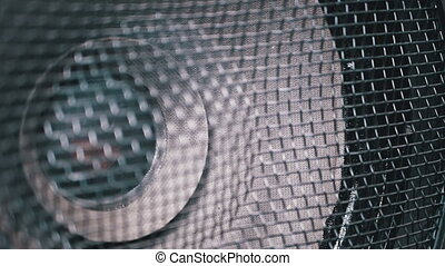 The Movement of the Vintage Paper Cone of Acoustic Sub-woofer Speaker. Slow Motion in 180 fps. Close-up of Bass speaker membrane vibration and playing. Loopable. Powerful kind of subwoofer vibrates at low frequencies. Loud Speaker in Action. Loudspeaker with protective mesh.