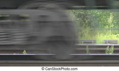 The movement of trains along the rails