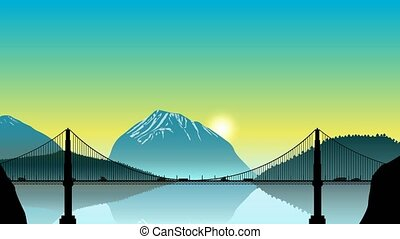 The movement of vehicles on the bridge, on the background of mountain scenery at sunset. Timelapse.
