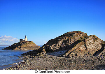 The Mumbles with it's lighthouse as seen from Bracelet Bay on the Gower Peninsular West Glamorgan Wales UK a popular Welsh coastline travel destination