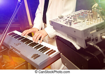 synthesizer - The musician plays on synthesizer, hands in...