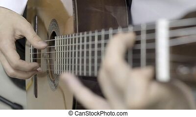The musician plays the classical guitar. Slow motion