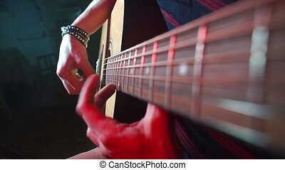 The musician plays the guitar at a concert.