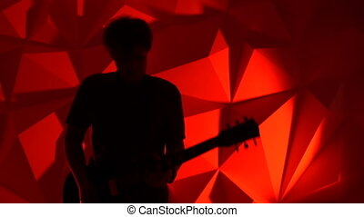 The musician plays the guitar. Rock guitarist silhouette on...