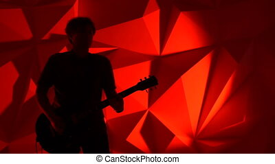 The musician plays the guitar