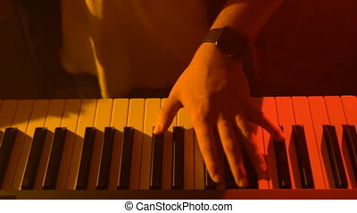The musician plays the keyboard. Close-up