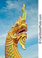 The Naga status on blue sky background