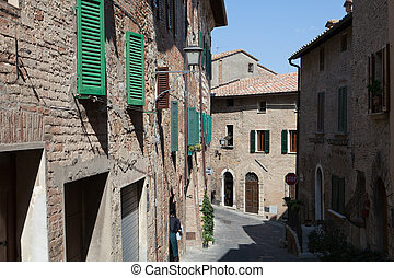 the narrow street in the Tuscan town