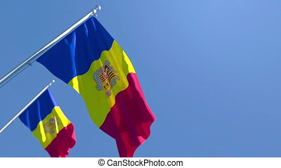 The national flag of Andorra is flying in the wind against a blue sky
