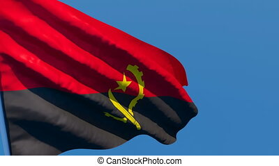 The national flag of Angola is flying in the wind