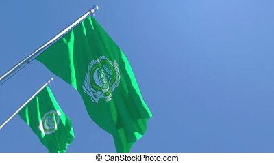 The national flag of Arabic league flutters in the wind against a blue sky