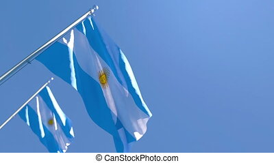 The national flag of Argentina is flying in the wind against...
