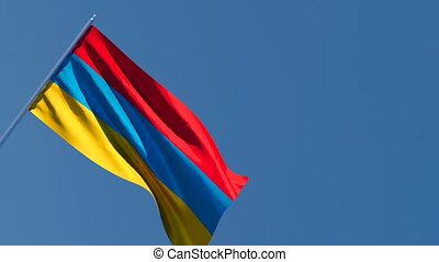 The national flag of Armenia is flying in the wind