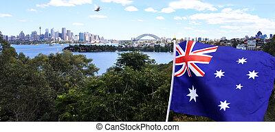 The National flag of Australia flay along Sydney skyline