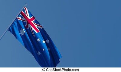 The national flag of Australia is flying in the wind