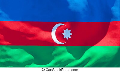 The national flag of Azerbaijan is flying in the wind
