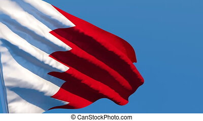 The national flag of Bahrain is flying in the wind