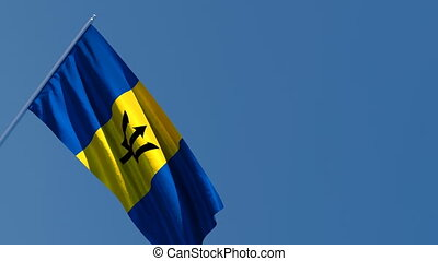 The national flag of Barbados is flying in the wind