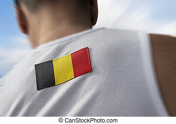 The national flag of Belgium on the athlete's back