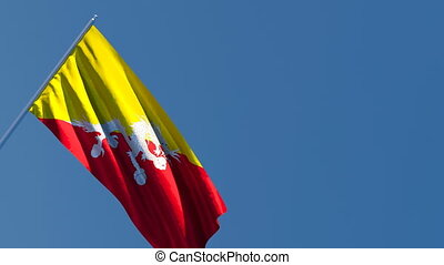 The national flag of Bhutan is flying in the wind