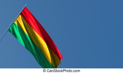 The national flag of Bolivia flutters in the wind