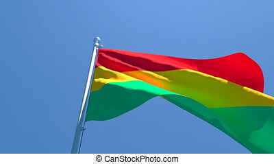 The national flag of Bolivia is flying in the wind.
