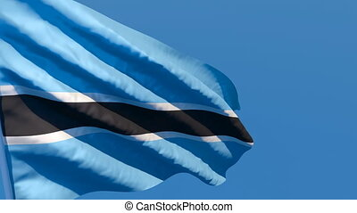 The national flag of Botswana is flying in the wind.