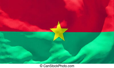 The national flag of Burkina Faso is flying in the wind.