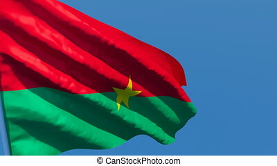 The national flag of Burkina Faso is flying in the wind