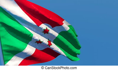 The national flag of Burundi flutters in the wind against a ...