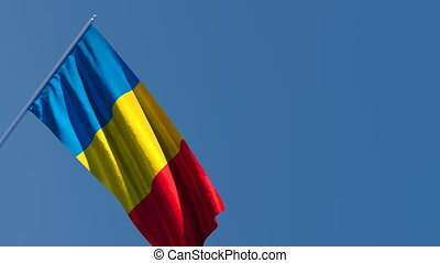 The national flag of Chad is flying in the wind