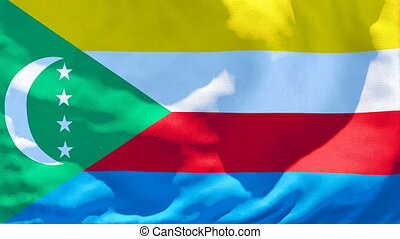 The national flag of Comoros is flying in the wind
