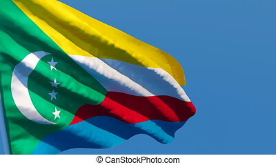 The national flag of Comoros is flying in the wind.