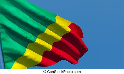 The national flag of Congo is flying in the wind.