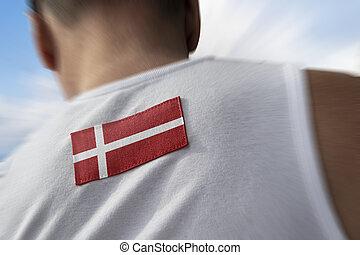 The national flag of Denmark on the athlete's back