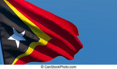 The national flag of East Timor is flying in the wind.
