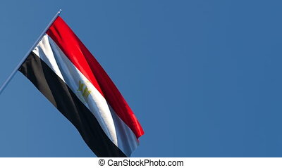 The national flag of Egypt is flying in the wind