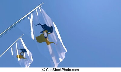 The national flag of Eurasian Economic Union flutters in the wind against a blue sky