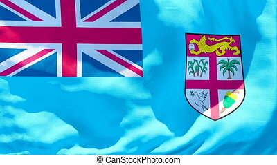 The national flag of Fiji flutters in the wind