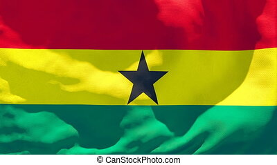 The national flag of Ghana is flying in the wind.