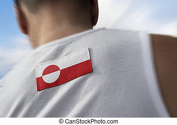 The national flag of Greenland on the athlete's back.