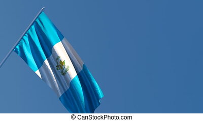 The national flag of Guatemala is flying in the wind
