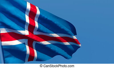 The national flag of Iceland is flying in the wind.
