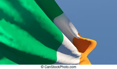 The national flag of Ireland is flying in the wind