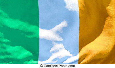 The national flag of Ireland is flying in the wind.